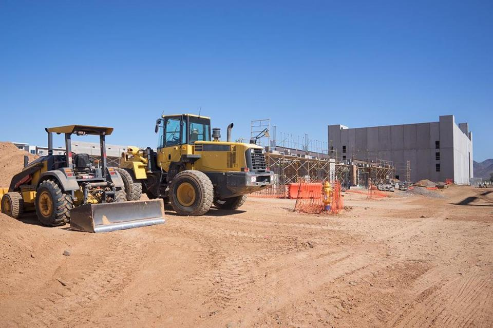 bulldozers sitting at worksite, retail, commercial, grocery, commercial construction, commercial remodeling, commercial contractors near me, commercial building construction, commercial general contractors, general contractor, retail building design, national retail contractors, construction services, building