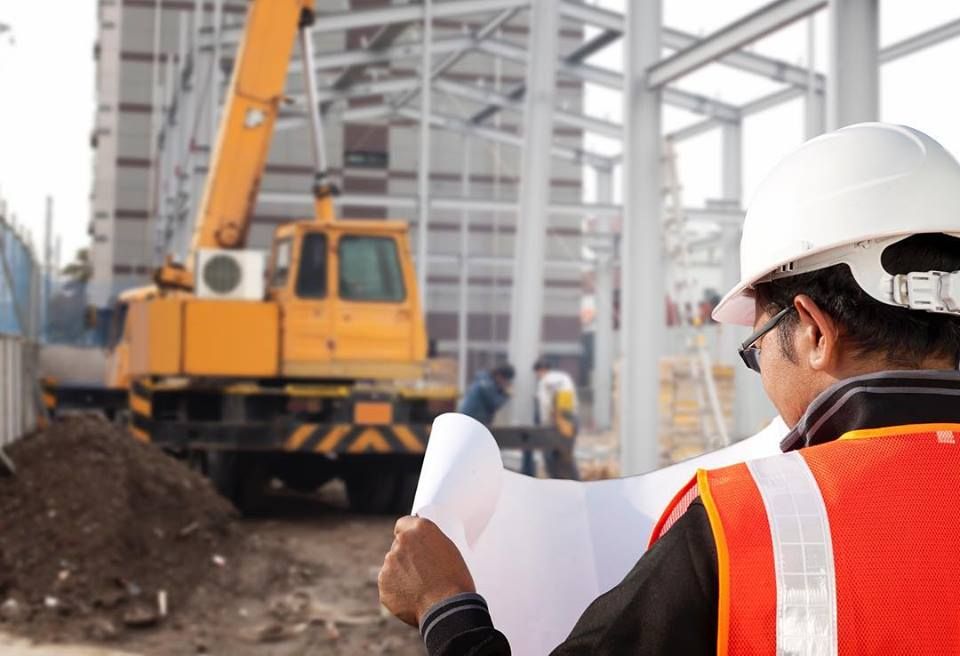 project manager looking at plans, retail, commercial, grocery, commercial construction, commercial remodeling, commercial contractors near me, commercial building construction, commercial general contractors, general contractor, retail building design, national retail contractors, construction services, building