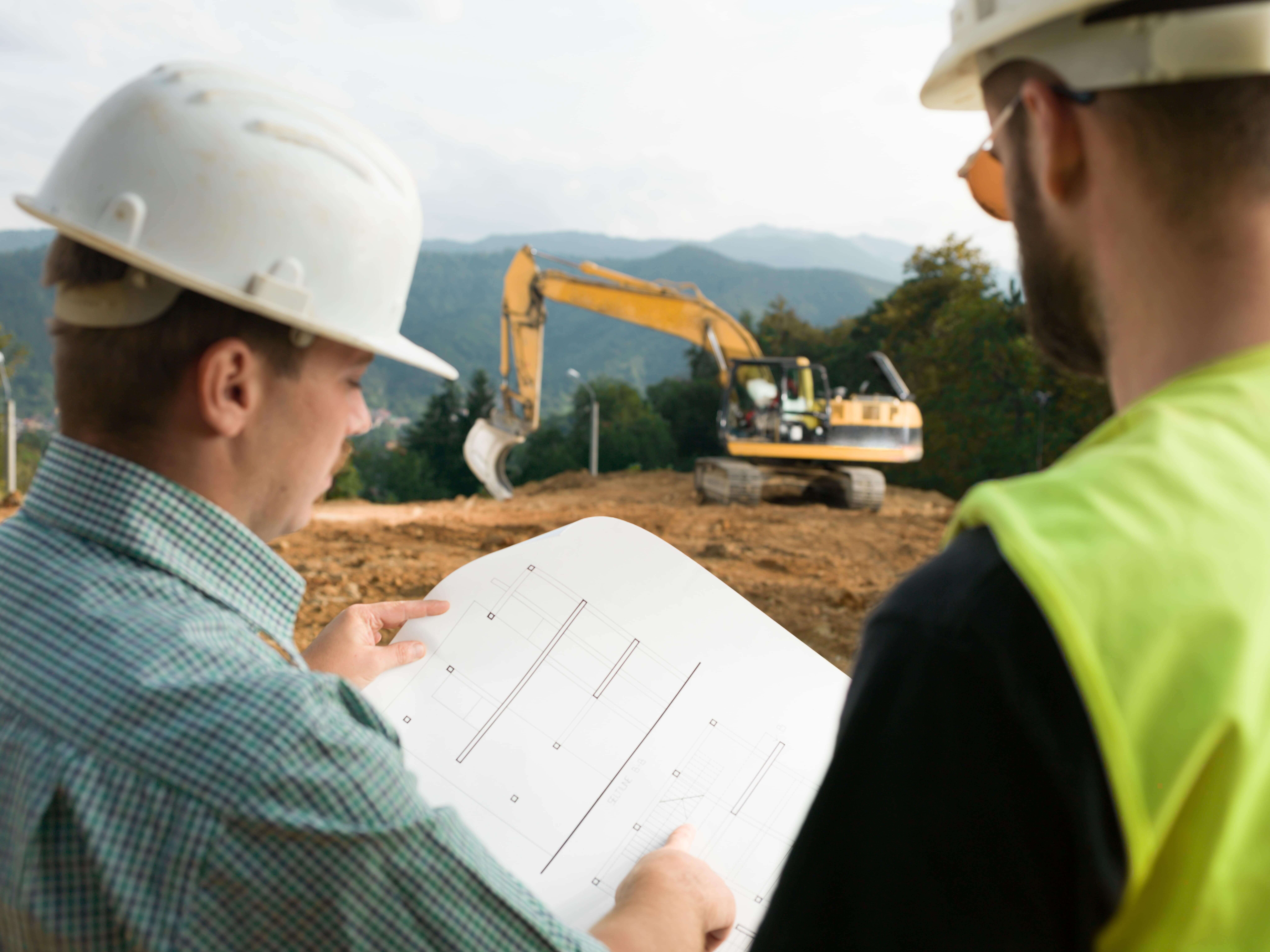 commercial contractor looking at plans, retail, commercial, grocery, commercial construction, commercial remodeling, commercial contractors near me, commercial building construction, commercial general contractors, general contractor, retail building design, national retail contractors, construction services, building
